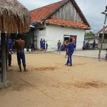Prisoners playing volleyball in Pursat Prison courtyard