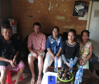 Thyda and her family, IBJ intern Jake Mooney and IBJ lawyer Ms Chan Reaseypheak (in the middle)