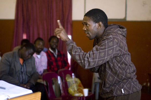 Alfred Magagula leads a discussion during a workshop with community police in Ngwenya