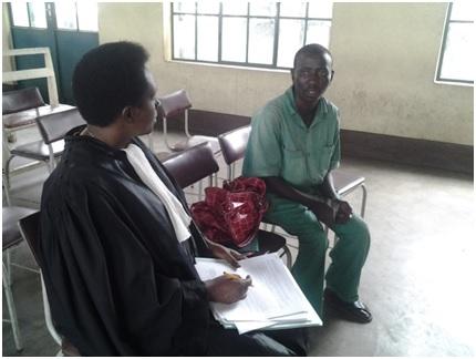 Lawyer Aline Nijimbere interviewing her client