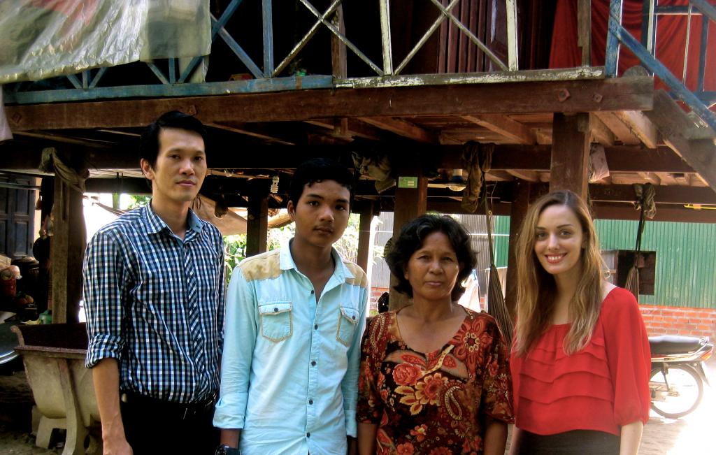 (Sothea (lawyer), Sopheak, Sopheak's mother, Me (legal intern); Taken at their home.)