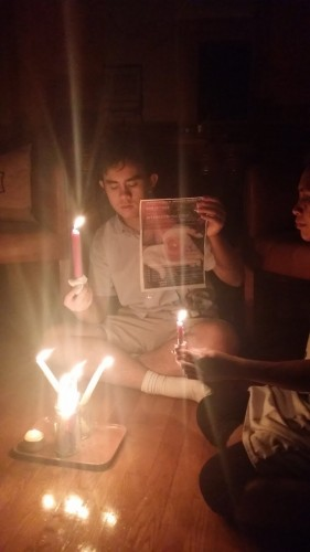 Youth Scholar Daniel Fung Jr. holding a vigil at his own place with family and friends in Hong Kong.