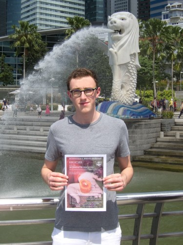 Youth Scholar Ethan Swift in front of the Merlion statue in Singapore