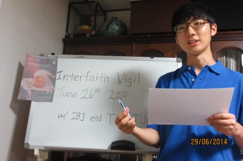 Youth Scholar Jihun Hong holding an Interfaith Peace Vigil for family and friends in Seoul, South Korea