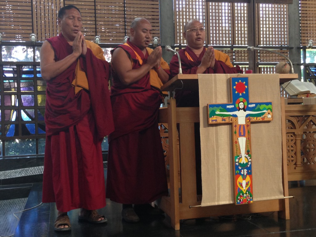 Three Tibetan Monks Othok Rinpoche, Geshi Luntok, and Geshi Gedun from the Shedrub Choekhor Ling Monastery and Buddhist Center in Mont Salève offering a chant