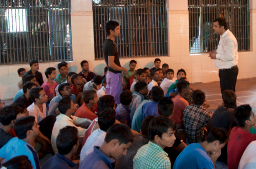 Ajay Verma, IBJ Legal Fellow, speaking with an inmate
