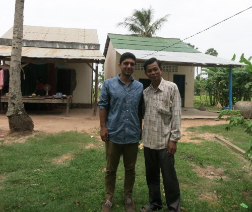Legal Program Associate Darius Rohani-Shukla and client Sok Chea