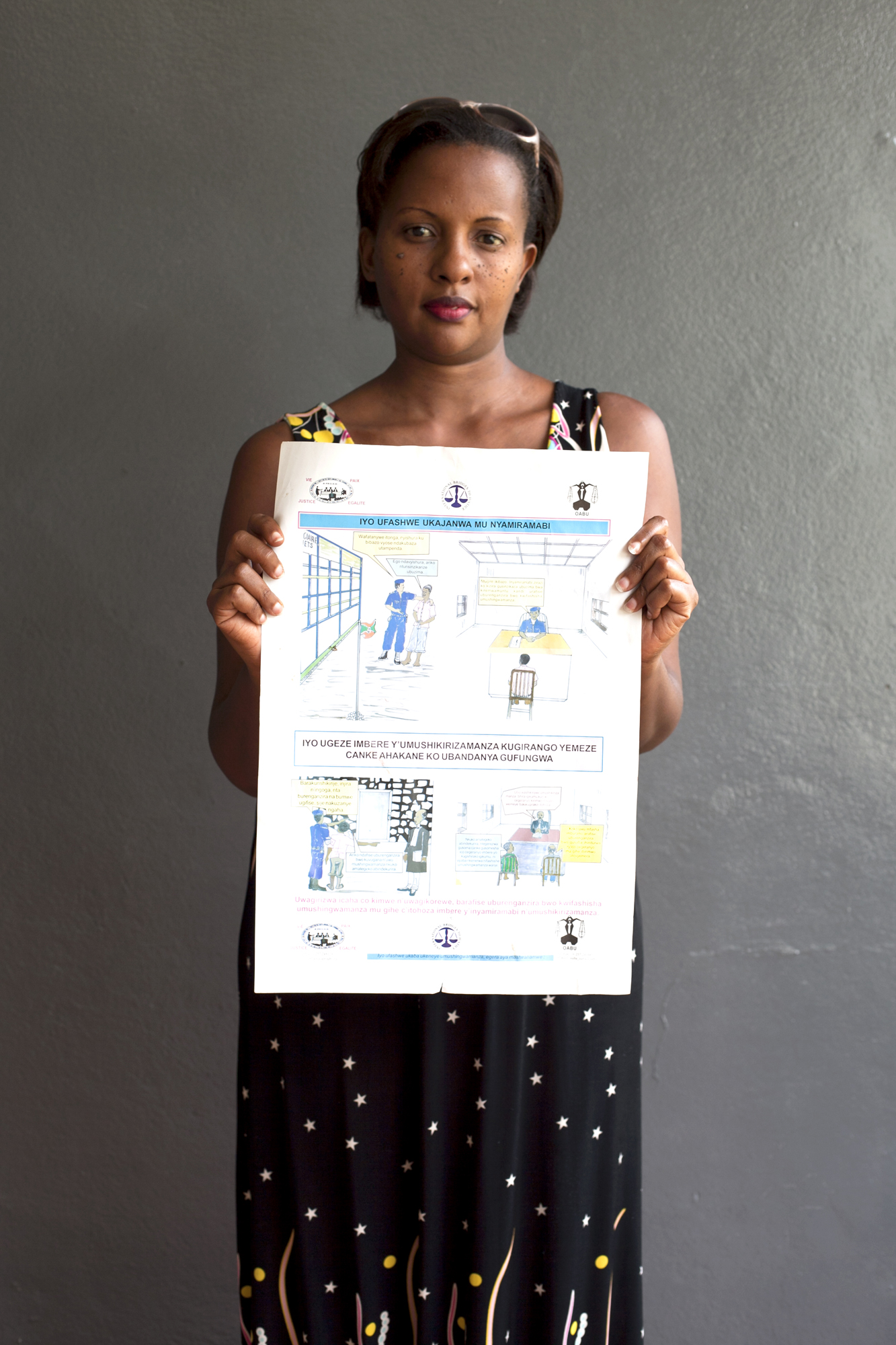 Selene showing a rights awareness poster prepared and distributed by IBJ's team in Bujumbura